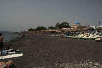 Black_volcanic_sand_beach_Kamari_Santorini